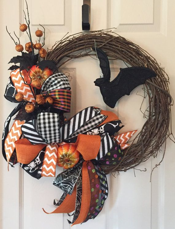 """This funky Halloween wreath is definitely a head-turner! I started with an 18"""" grapevine wreath. Eight different ribbons were selected to create #halloweenwreaths"""
