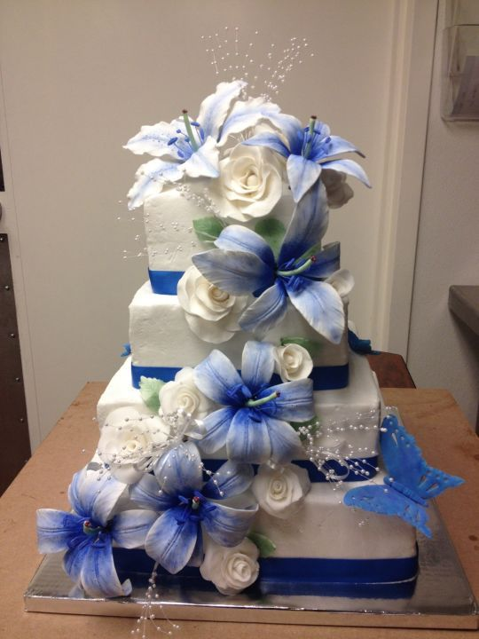 Blue Lily Wedding Cake Handmade roses and lilies all edible