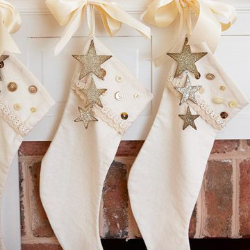 Simple but pretty stockings.  just add buttons to stockings and hang glitter stars in front.