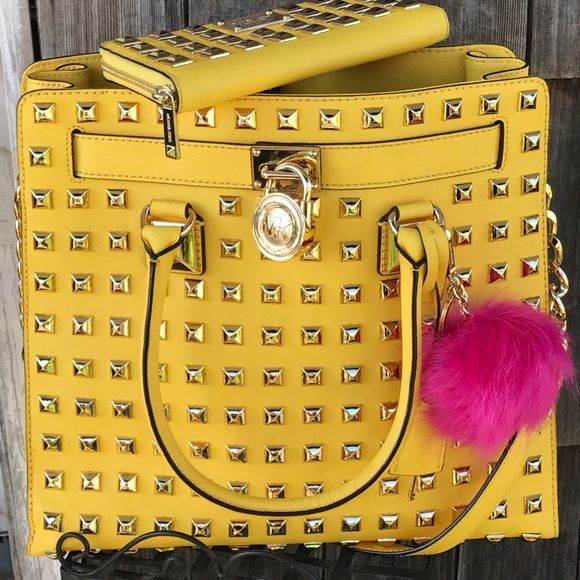 😍JUST SHARING 😍! STUNNING 😍❤️😍❤️😍❤️!! ABSOLUTLEY beautiful & 100% authentic Michael Kors Citrus Yellow Large Hamilton Pyramid Studded set ! Excellent used condition as you see in pics 😍! Any Q's feel free to shoot tag me 😉! It's also up on eBay for less , I'd interested let me know & I'll give you the item # & my eBay username ! Thank you 😊 Michael Kors Bags Satchels