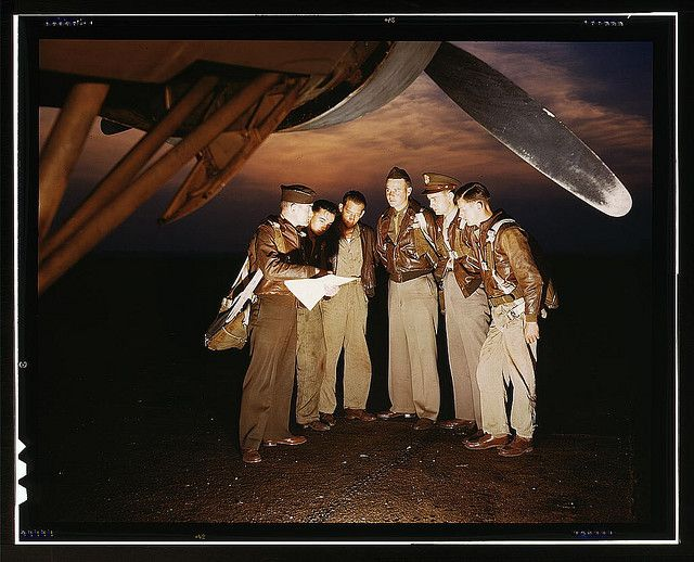 Here's our mission. A combat crew receives final instructions just before taking off in a mighty YB-17 bomber from a bombardment squadron base at the field, Langley Field, Va.  (LOC)
