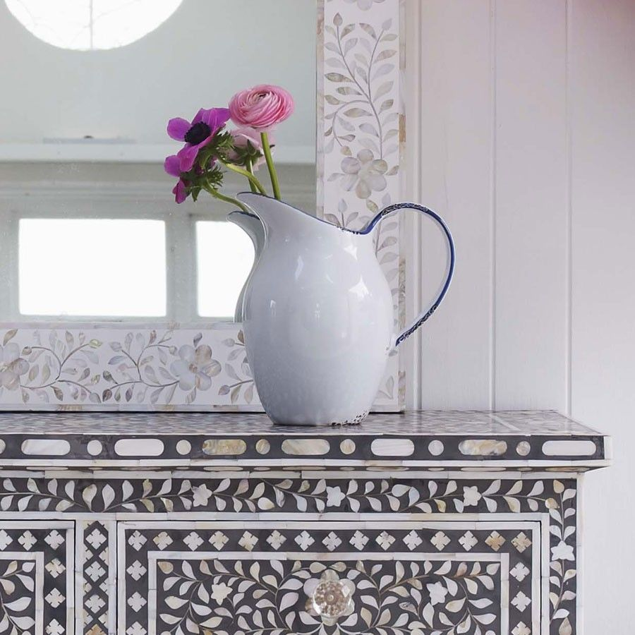 This large white enamel effect pitcher is an instantly recognisable ...