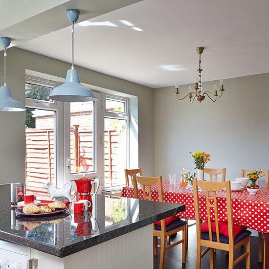 Warm Grey Kitchen With Red Accessories