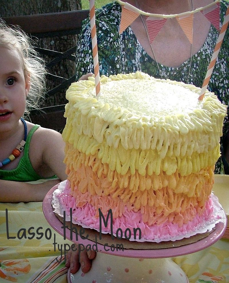Ombre Seuss-like birthday cake.  use a ribbon frosting tip to created the design in 6 gradient colors.  1st birthday