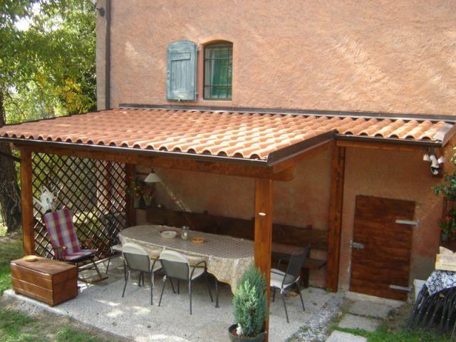 Lf arredo legno bologna tettoia in legno portico for Ville con portico in legno