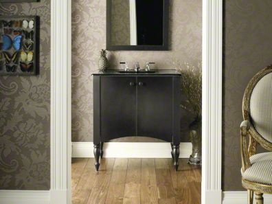 with a design inspired by early colonial furnishings the bathroom vanity cabinet combines antique style with convenient modernday features