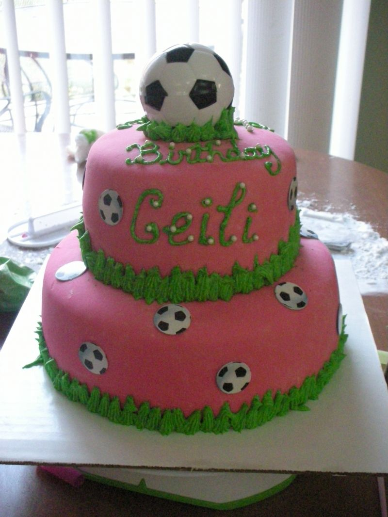 Adorable pink green Soccer Cake Someone needs to make one of