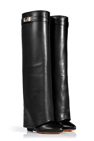 Make a stunning statement on style in Givenchy's ultra chic black wedge boots, detailed with fierce shark tooth turnlock closure for opulent results guaranteed to make an impact.