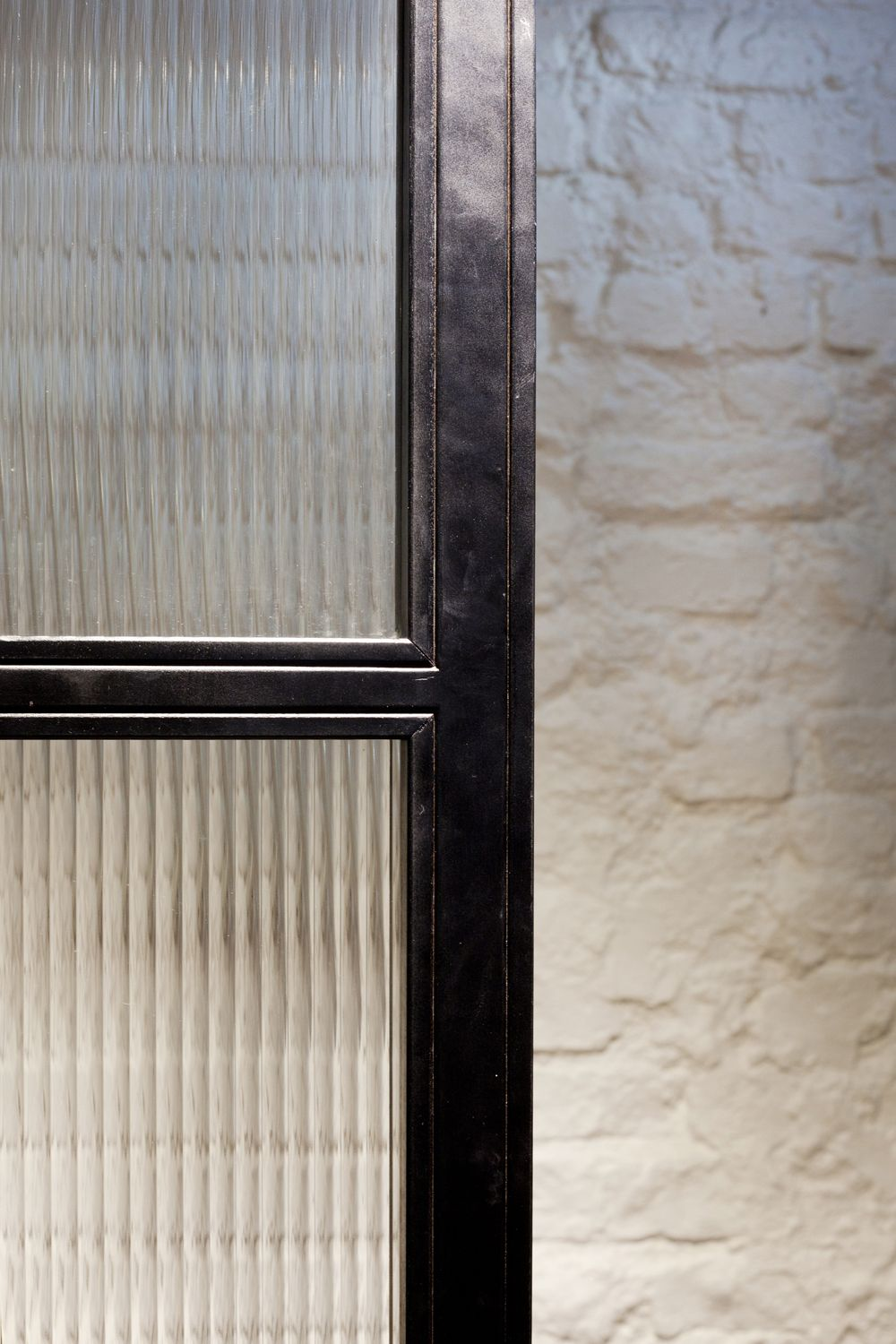 Ribbed Glass. Metal frame. White washed painted exposed brick. 125 ...