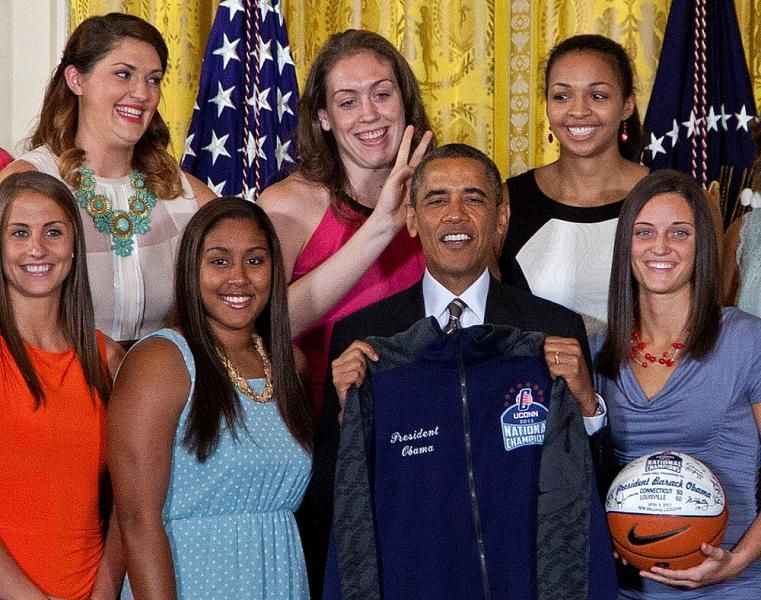 University of Connecticut Huskies basketball center Stefanie Dolson, top left, give the 'bunny ears' to President Barack Obama as he poses for photo with the team during a ceremony in the East Room of the White House in Washington, Wednesday where the president honored their 2013 NCAA Womenís Basketball Championship win. Also seen, from top left, Breanna Stewart, Kiah Stokes, bottom left, Caroline Doty, Kaleena Mosqueda-Lewis and Kelly Faris. (Carolyn Kaster/AP)