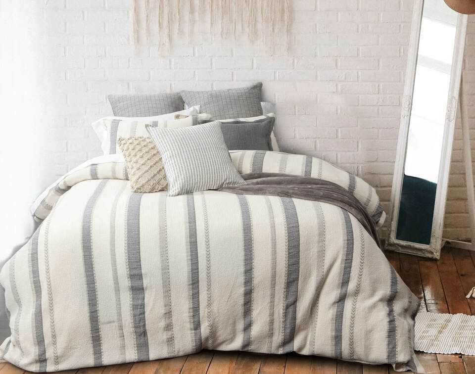 Everett Duvet Cover, front view in a bedroom with a wood accent wall