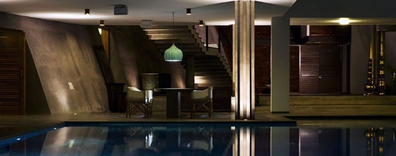 Modern Luxury Home in India Boasts An Enormous Infinity Pool, Angular Architecture and Serene Interiors.