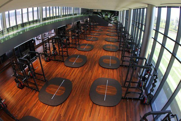 The New Weight Room Contains Ample Space For The Team And On The Mezzanine A 40 Yard Electronic Track Lane Oregon Football College Workout Workout Plan Gym
