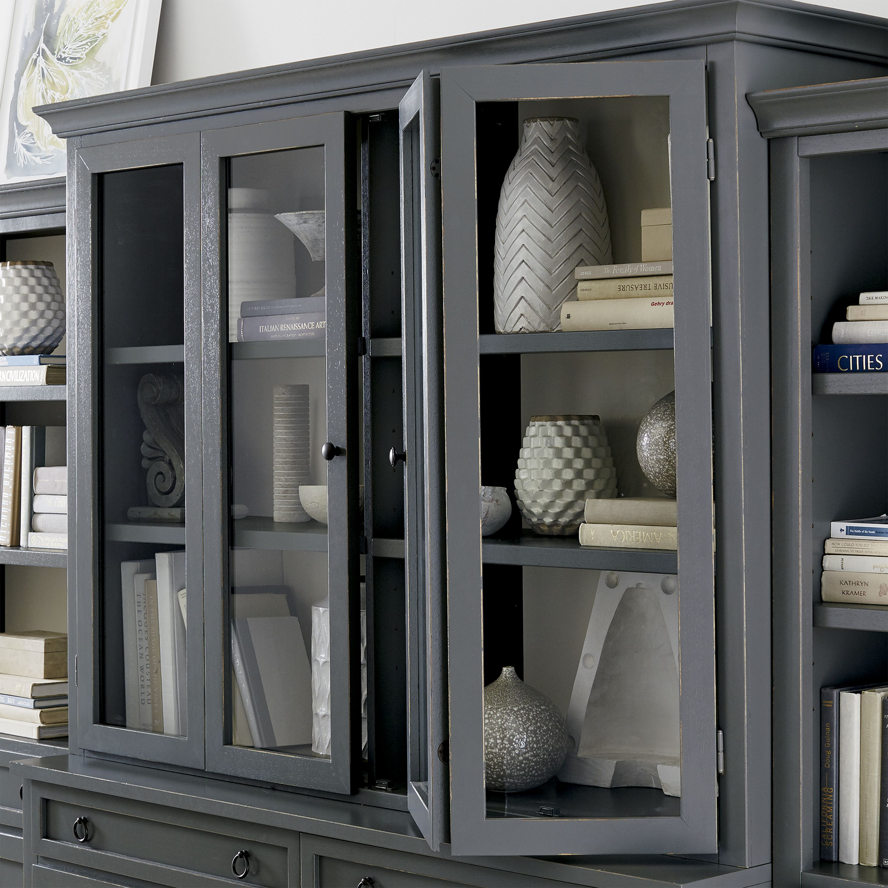 Making an extended cameo appearance in the living room family room or den this versatile modular collection including the media console and hutch with