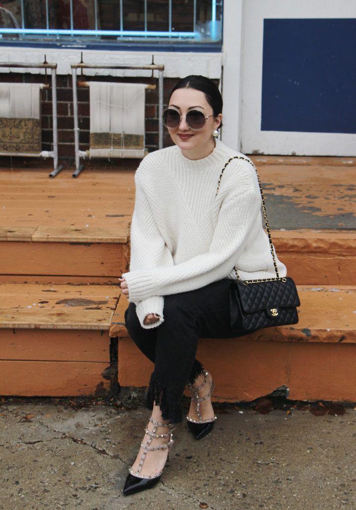 chloe-carlina-sunglasses; chanel 2.55 bag; fringe hem jeans; valentino rockstud shoes