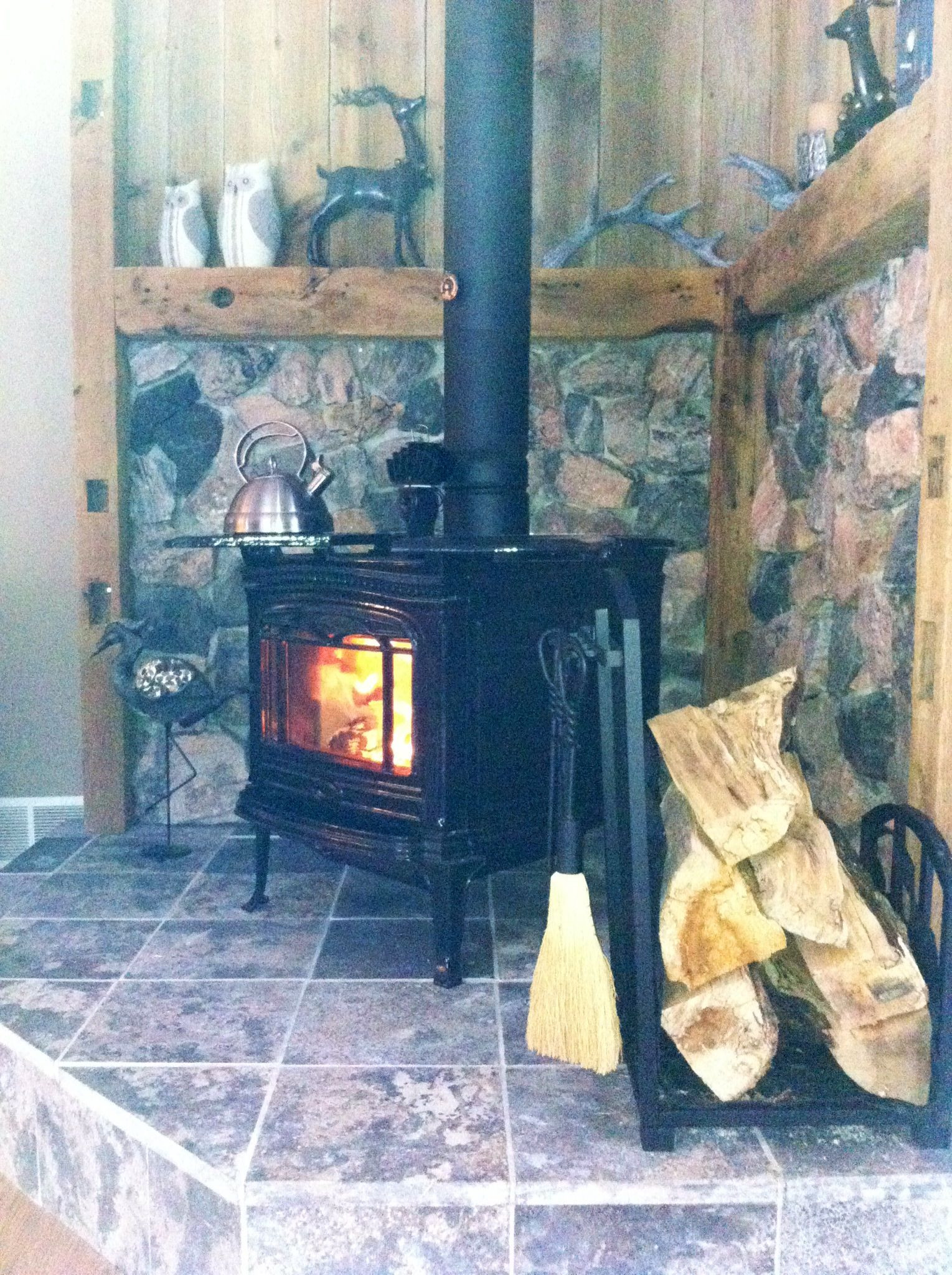 Rustic stone surround and wood stove