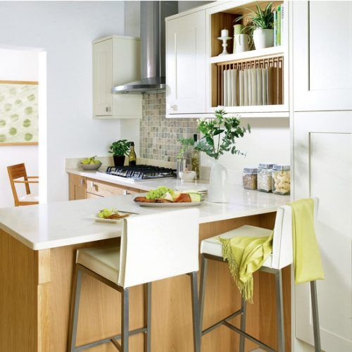 Small Kitchen With Cream Cabinetry, Cream Worktops, Integrated Breakfast Bar  And Leather Stools