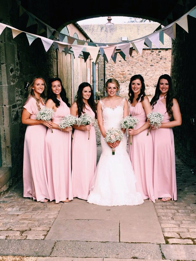 The bride and the bridesmaids in their light pink debenhams multiway ...