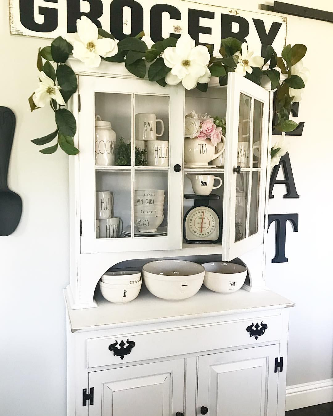 Spring decor and Rae Dunn display in a Farmhouse style hutch painted ...