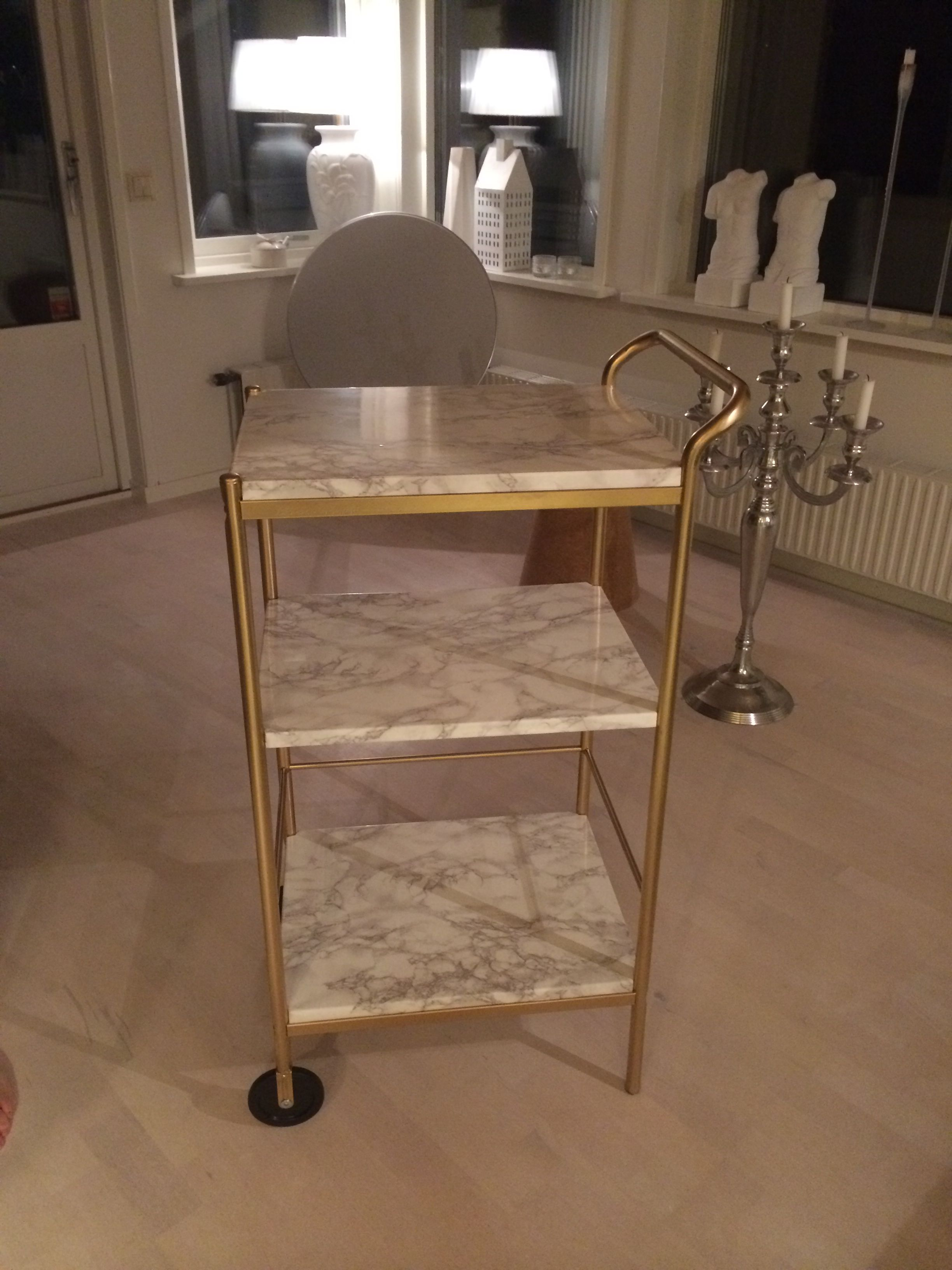 Ikea bygel table redone with plastic marble and gold spray déco