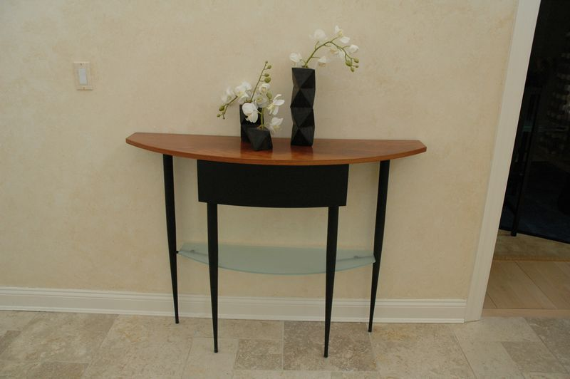 """Modern wood and glass shelf, foyer, demi lune table with hand carved ebony wood table articles/ candle holders. Table is 48""""x14""""x36."""""""
