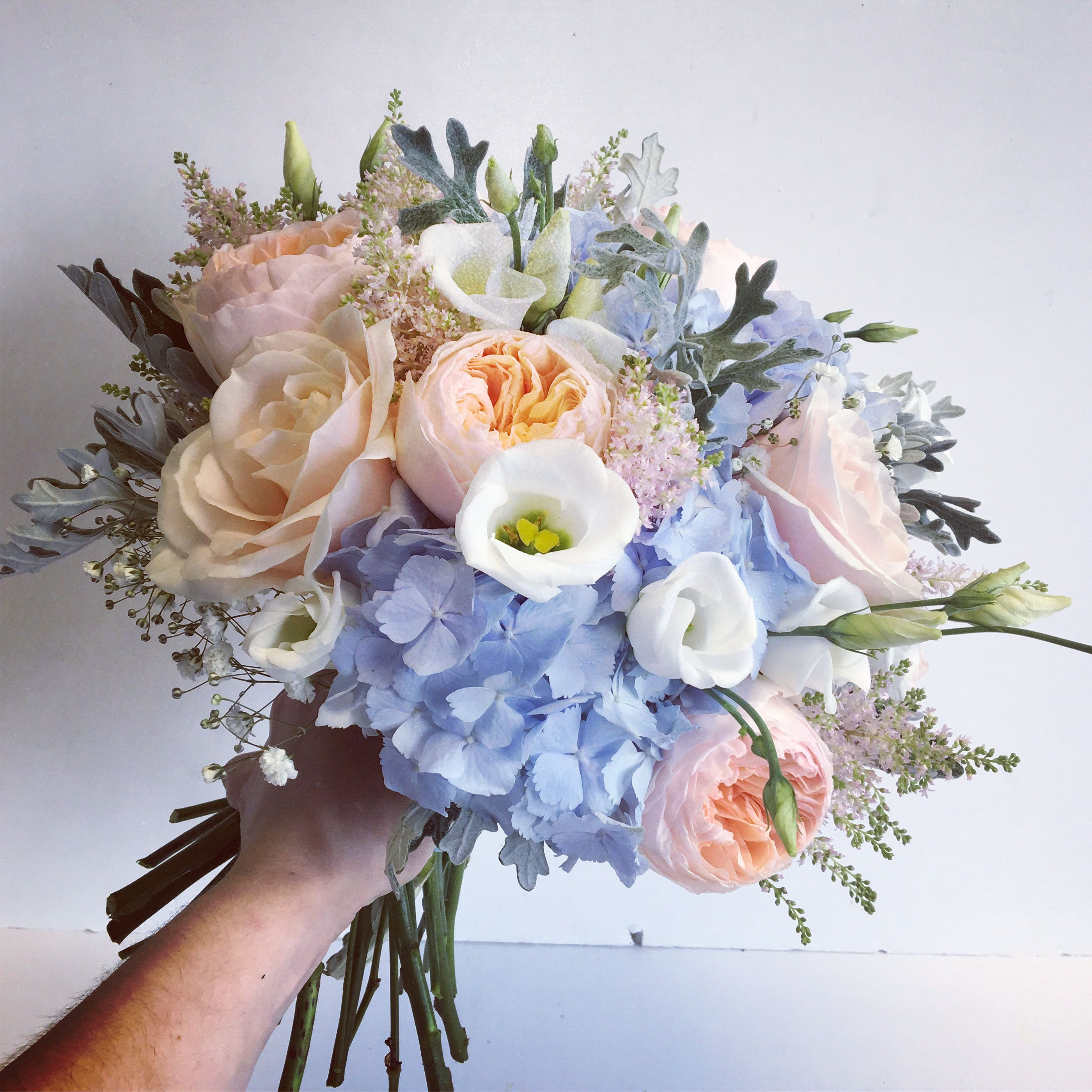 Pink Peach And Blue Bridal Bouquet Including Hydrangea And Roses