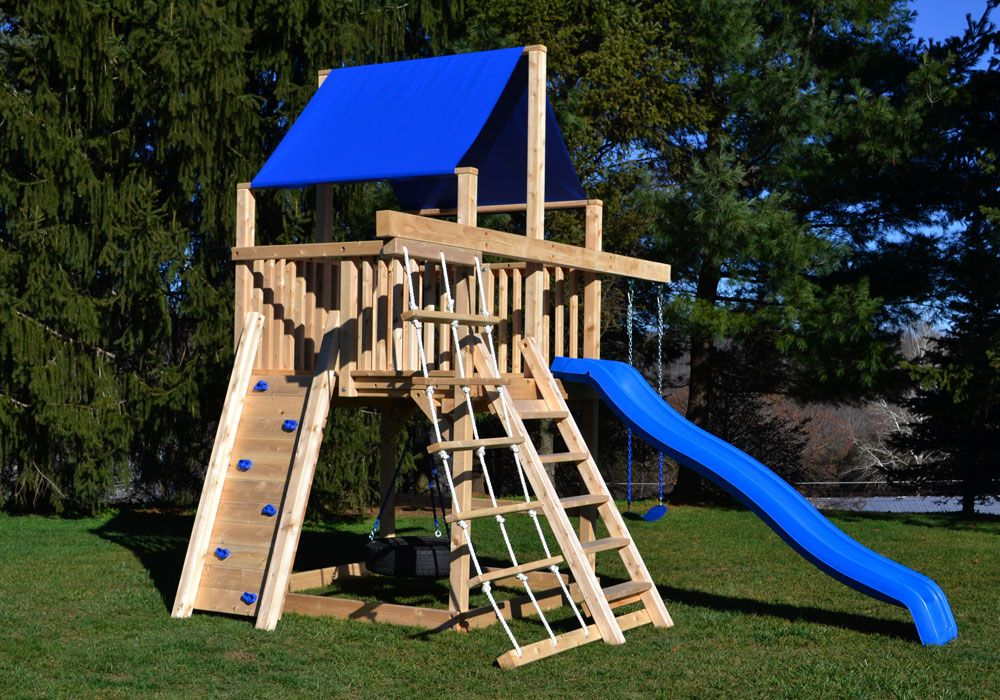 Triumph play system 39 s bailey wooden swing set with tire for Tire play structure