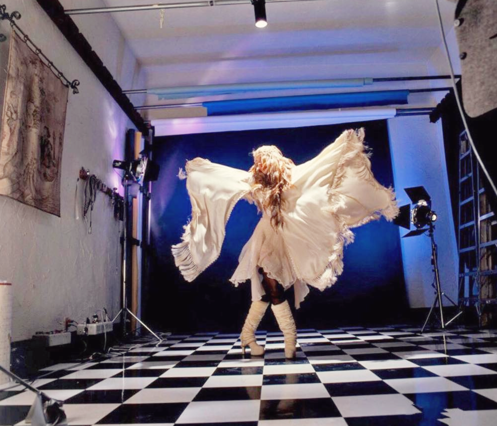 Stevie ~ ☆♥❤♥☆ ~ in a stunning white outfit and a complex pose, especially her booted feet; photo by Herbert W. Worthington 111, a 'Bella Donna' outtake, 1981; love Herbie's studio with that black and white tiled floor ~ wouldn't it have been something to have seen & heard what went on on that floor
