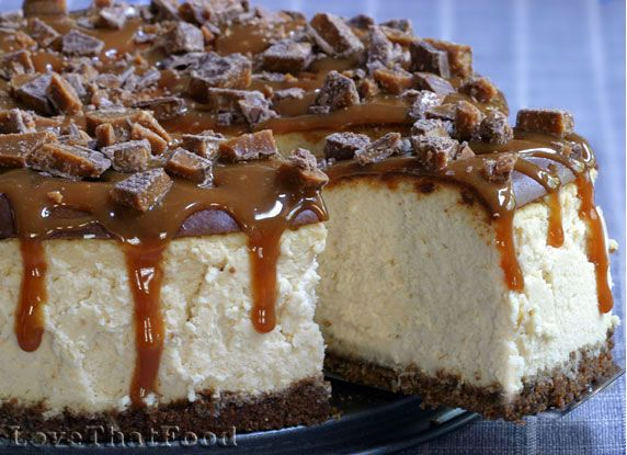 A rich and creamy brown sugar-sweetened cheesecake on a ginger snap cookie crust, topped with caramel and broken bits of English toffee candy, dulce de leche cheesecake.
