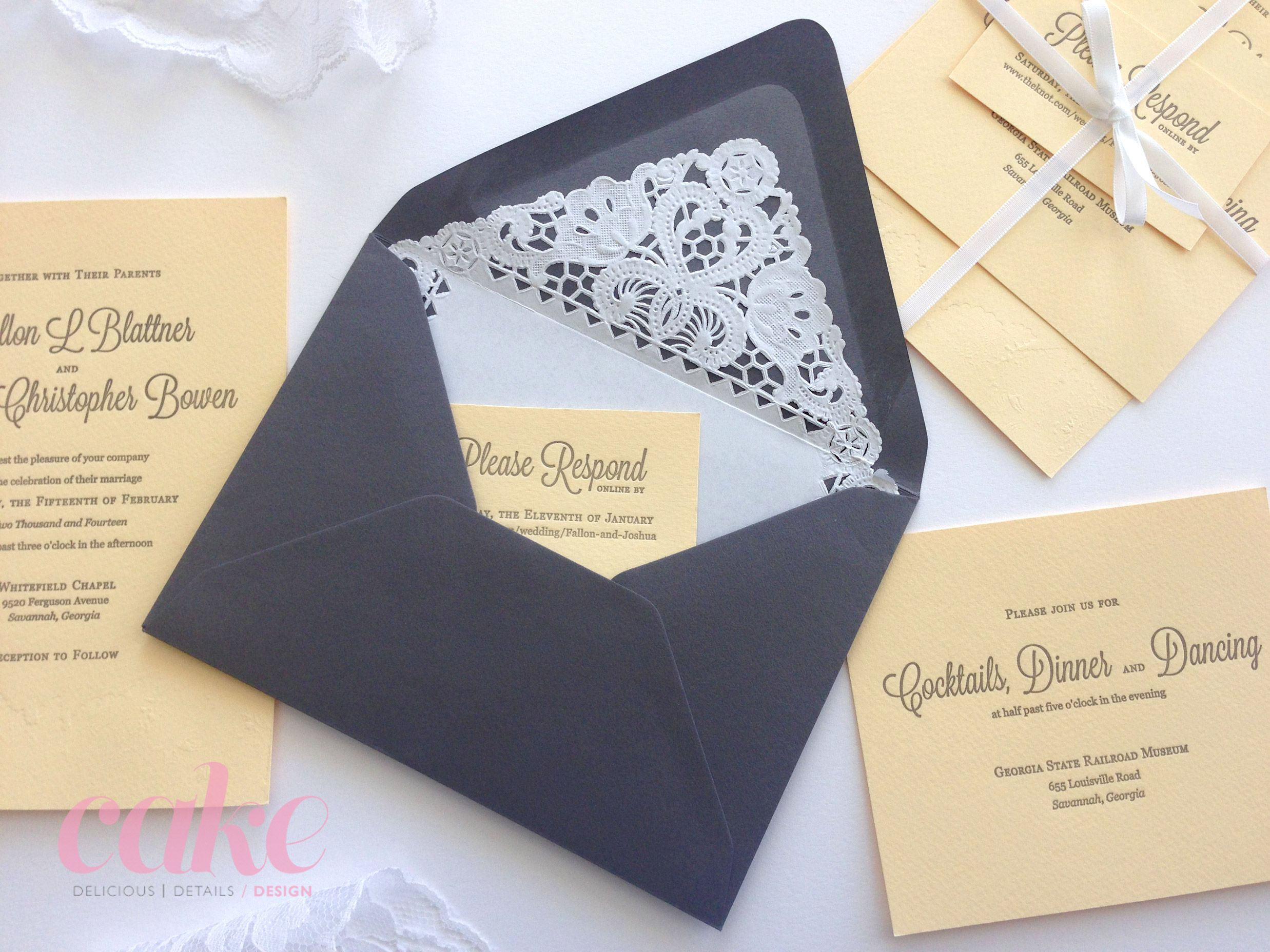 Invitation suites were tied with white satin ribbon and tucked into