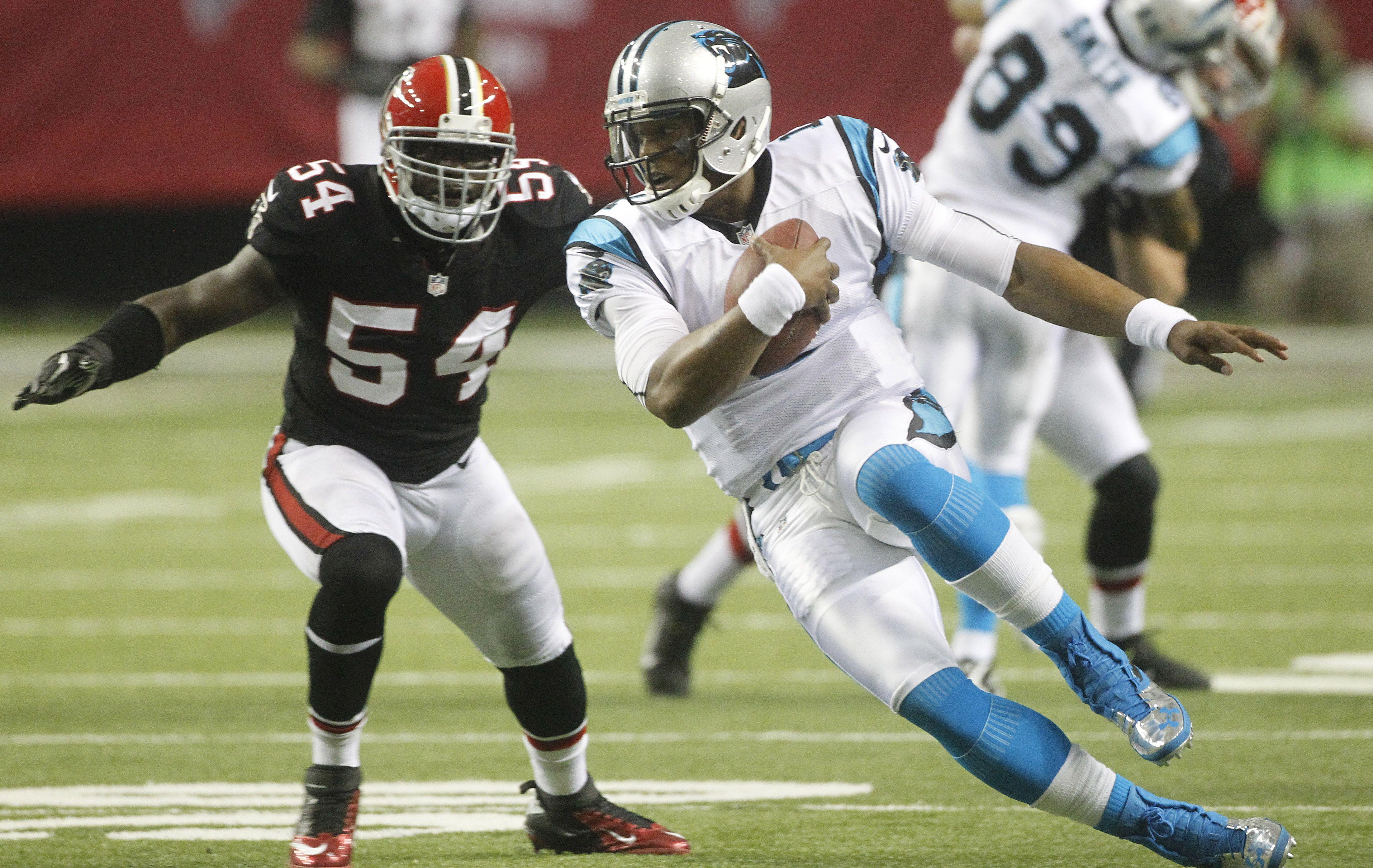 Cam Newton Carolina Quarterback Cam Newton Scrambles Against The Atlanta Falcons Cam Newton Football Helmets Newton