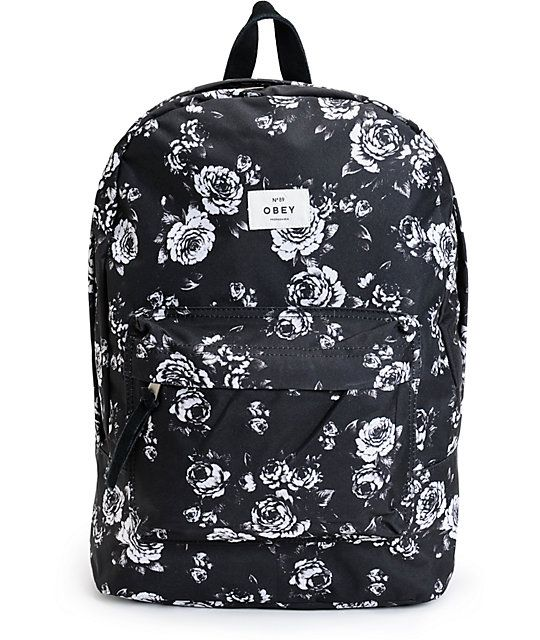 094e1aecccc4 A black and white rose print covers this mid-size backpack made with ample  storage space including a padded laptop sleeve so you know your style and  ...