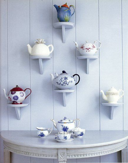 SFH adds: An interesting display of this collection of tea pots. However, I think the brackets are out of scale with the pots. Too small. Take this same idea, but think...scale.