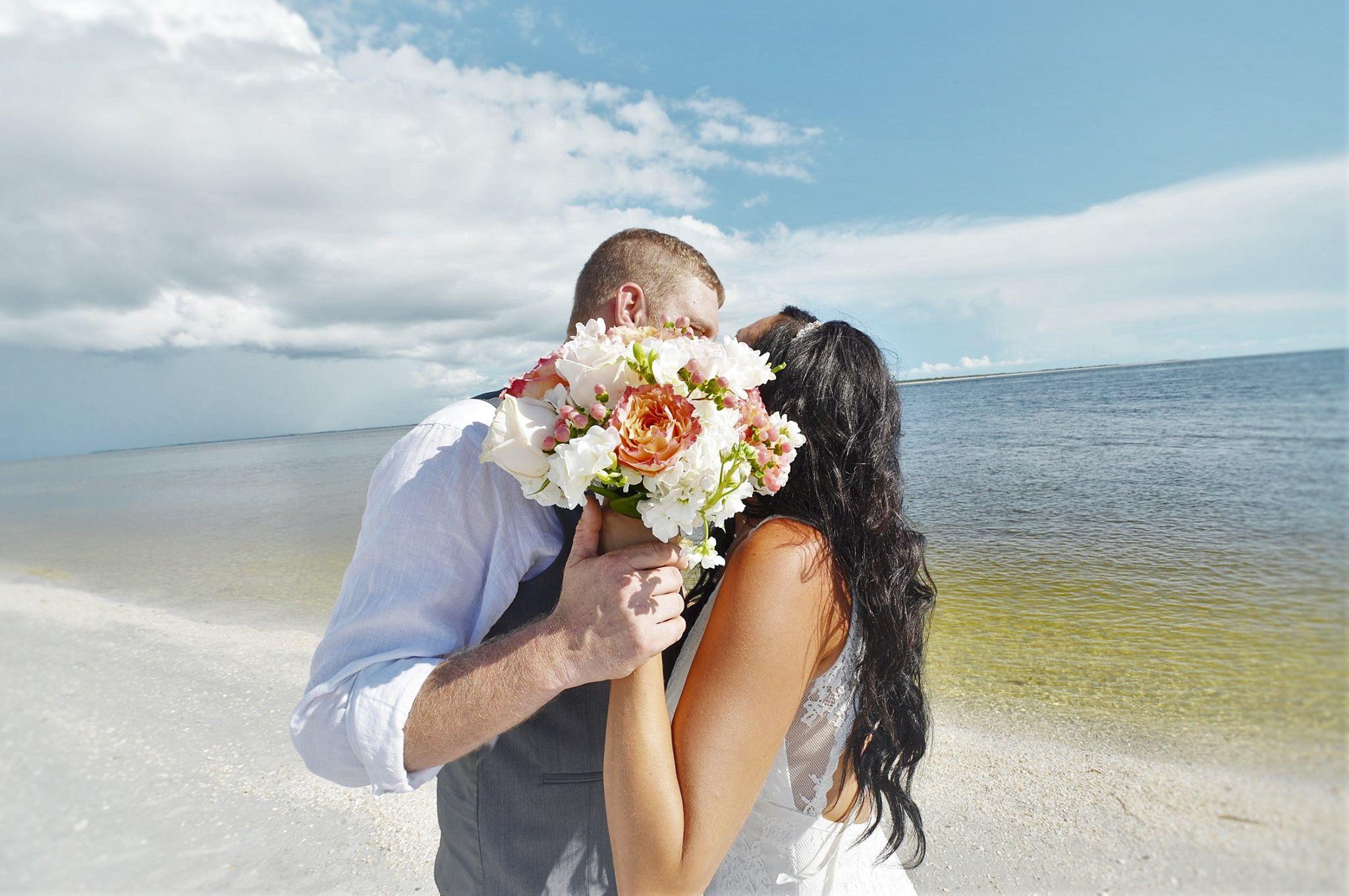 Long beach lighthouse wedding  Rustic beach wedding Florida lighthouse white sheers bamboo