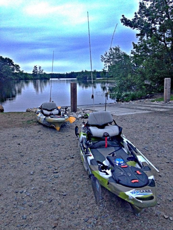 Two feelfree kayaks rigged and ready for some nighttime for Kayak fishing gear