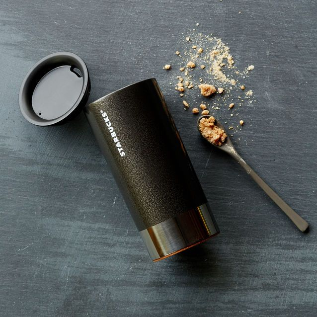 A Stainless Steel Coffee Mug With Modern Styling And Black
