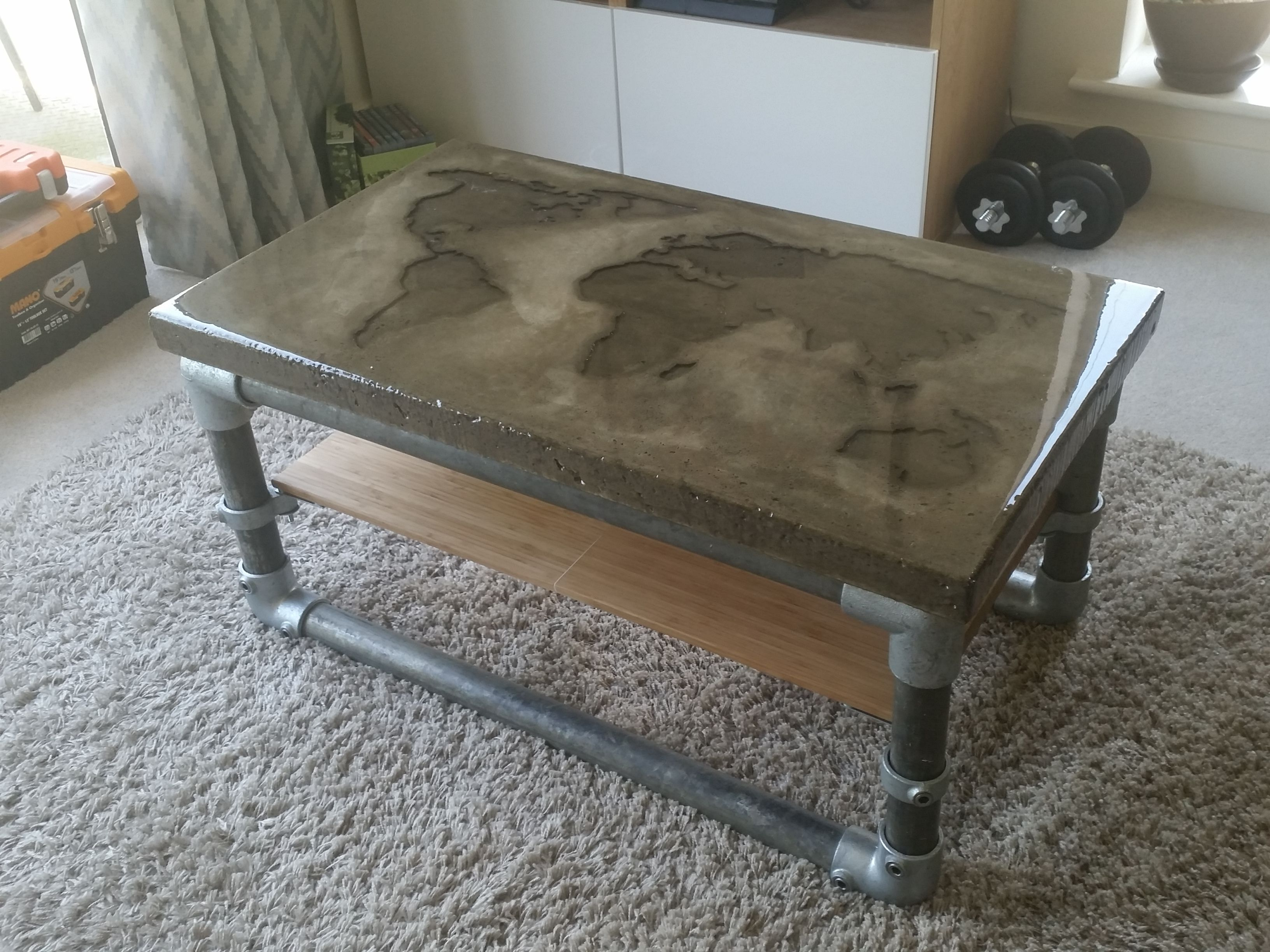 I made a concrete coffee table with a recessed world map ...