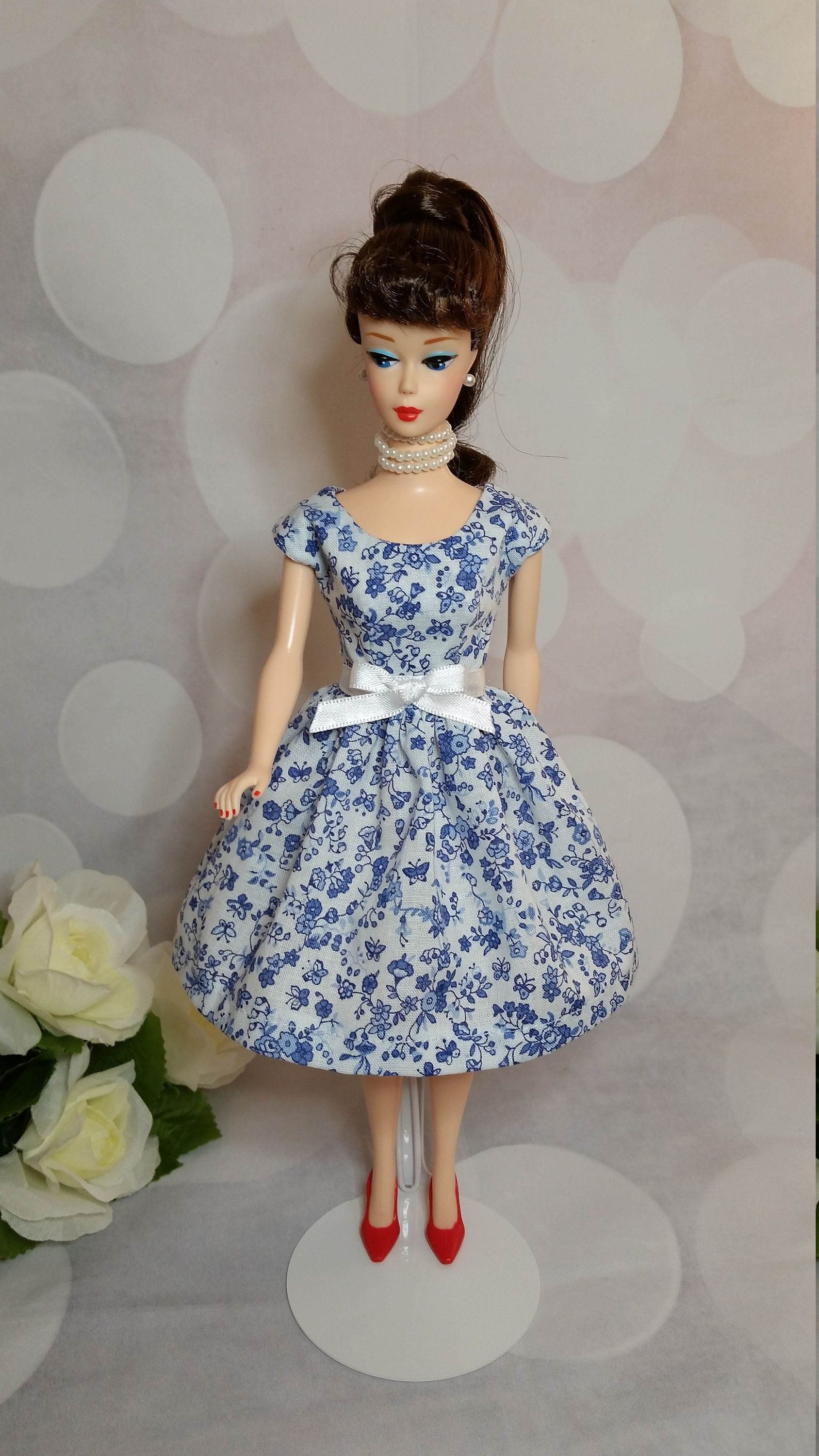 A Little Purple Dress with a Butterfly on the Botice Made to Fit Barbie Doll