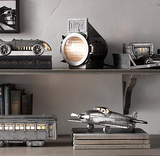 Vintage Rail Car Table Lamp. Love the lamp and the metal cars and plane on the shelf!