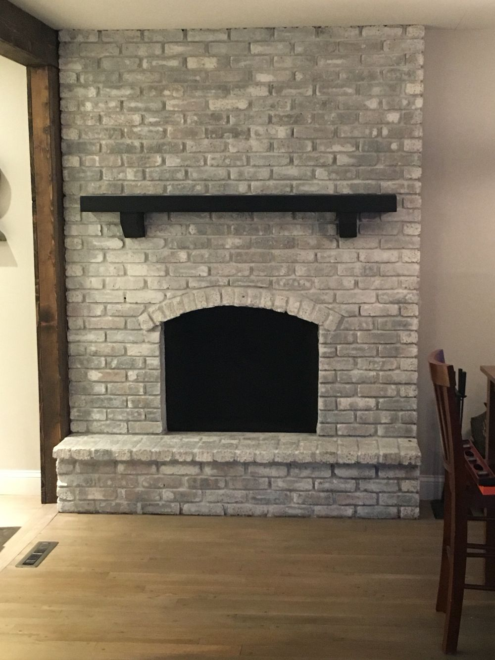 Whitewashed Fireplace With Black Mantel Brick Fireplace