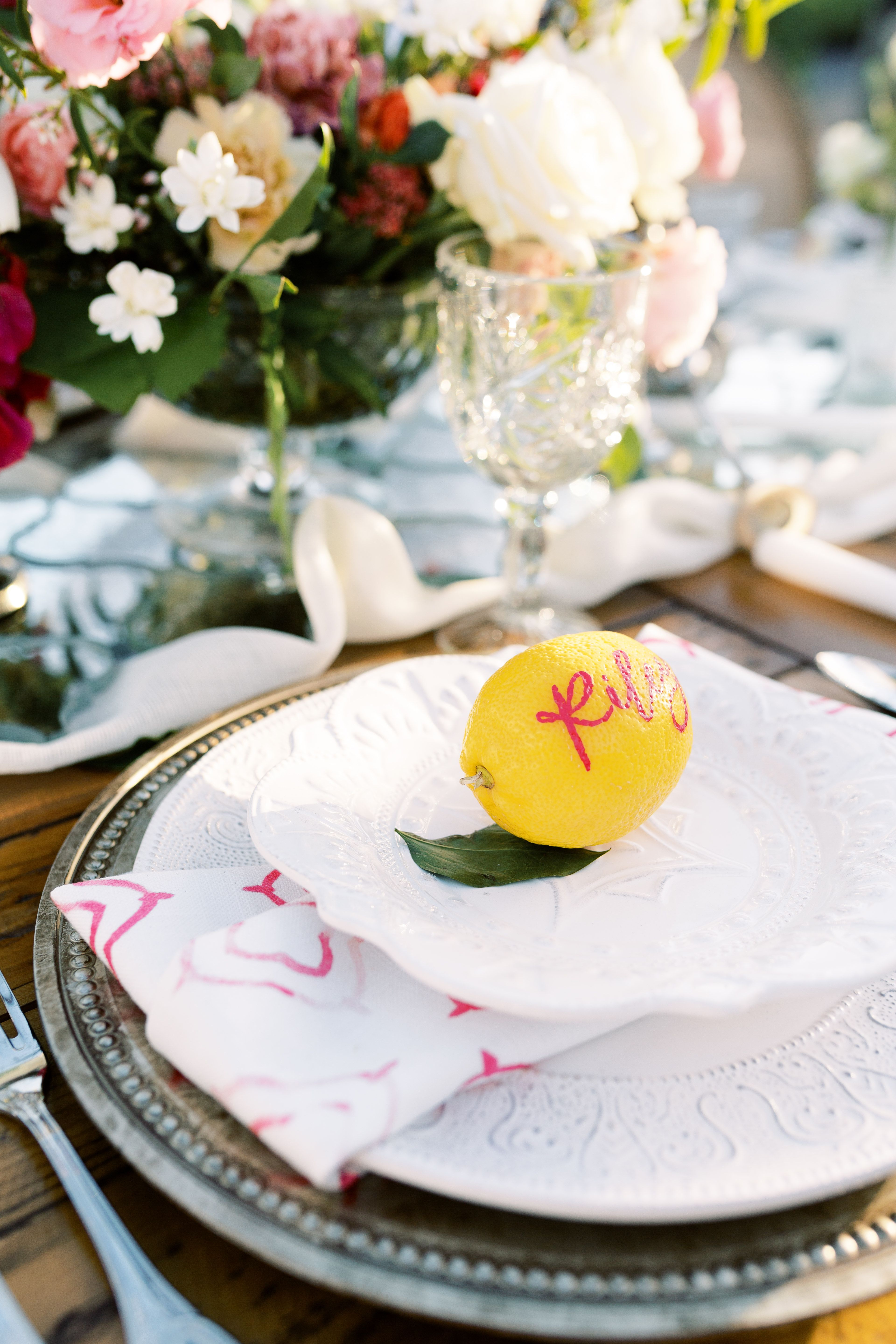 Cute Escort Card Idea Calligraphy on a lemon! Such a cute idea. See more ideas from luxury wedding planner, Mandy Marie Creative here.
