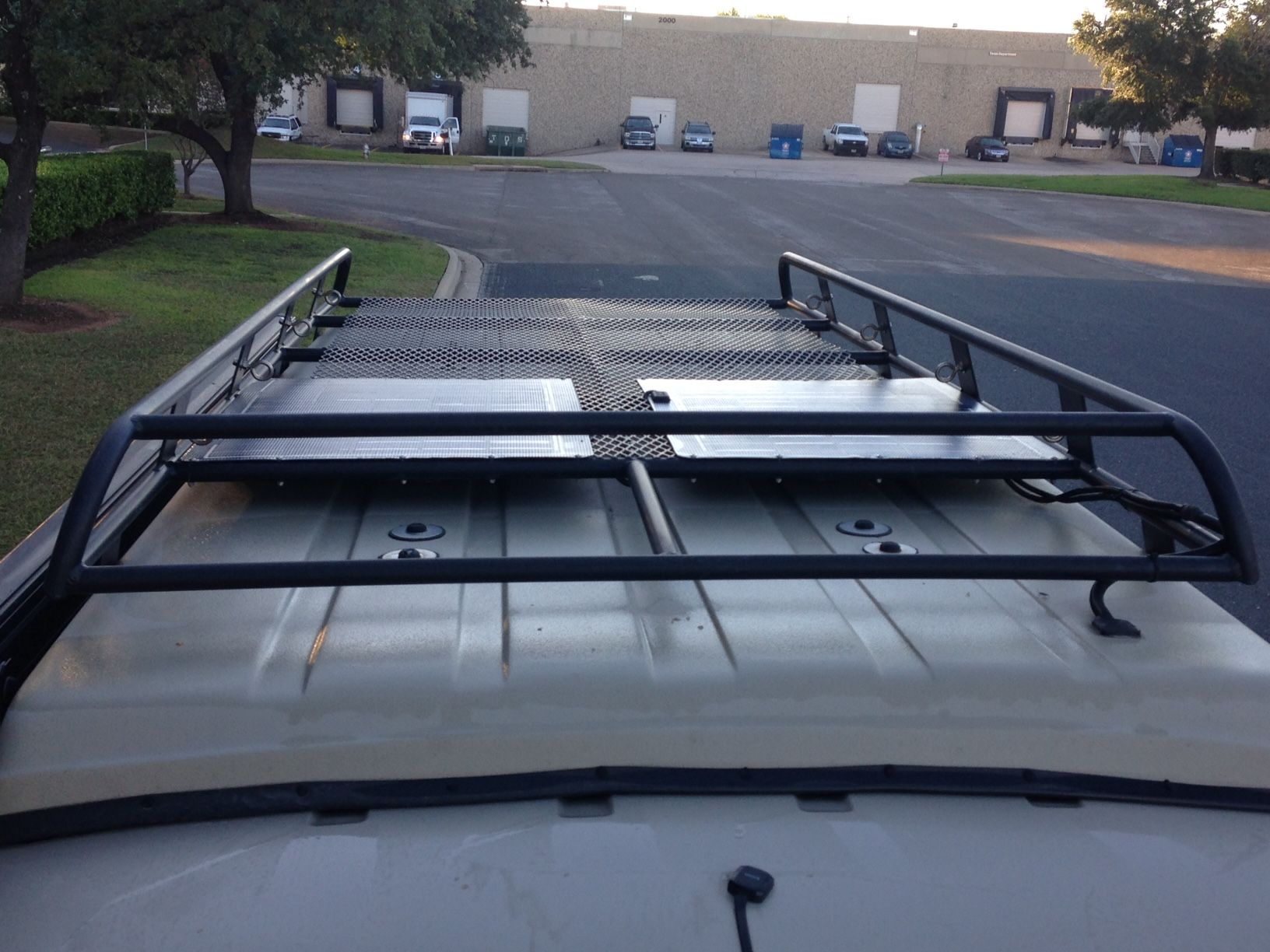 Sportsmobile with Aluminess roof rack on penthouse top