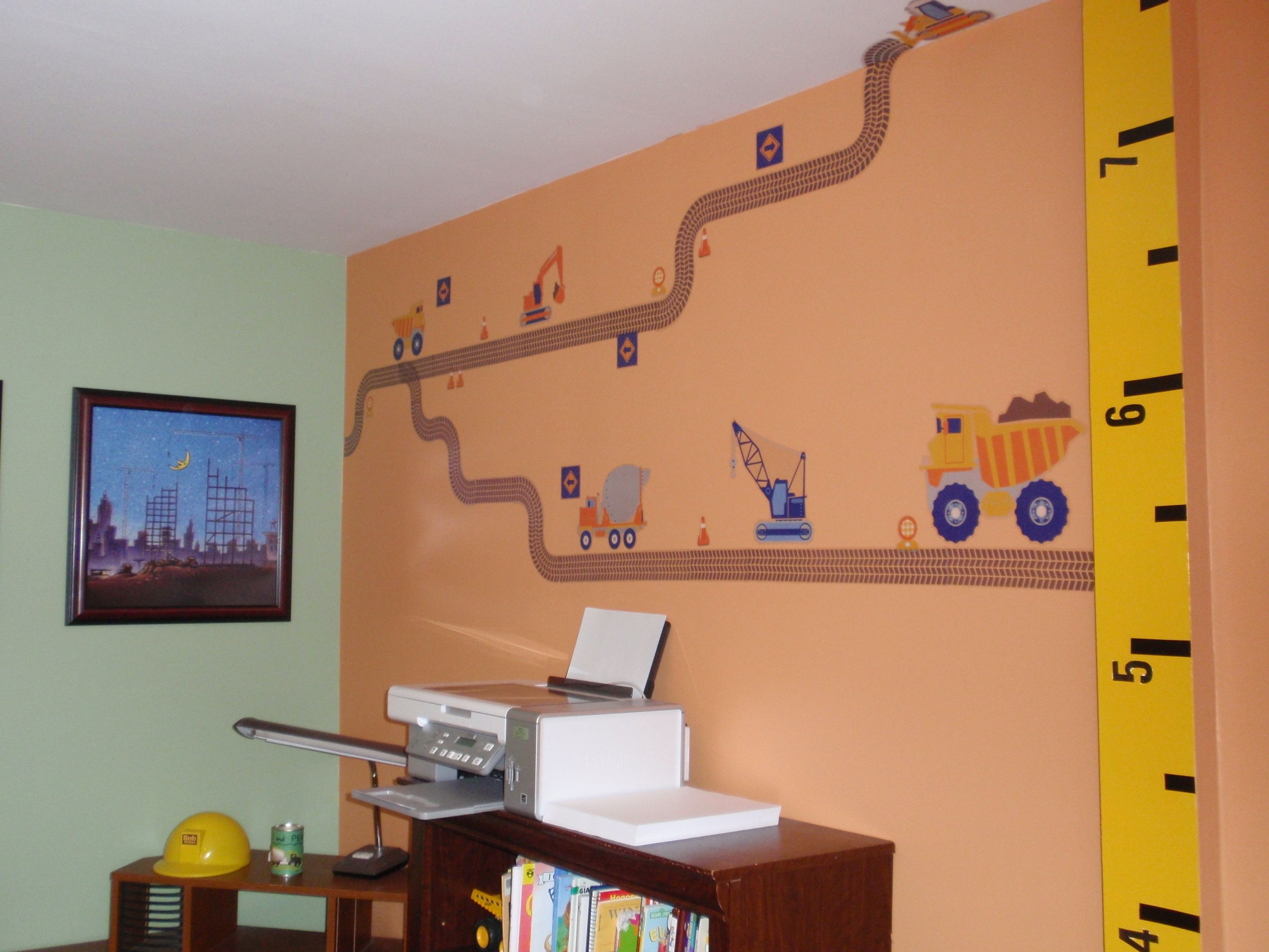 Construction themed toddler boy's room. Tape measure growth chart, vinyl  construction truck wall hangings