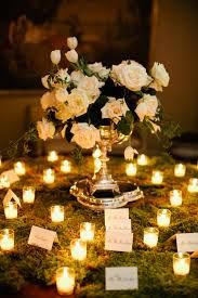 Glowing moss escort card table. Enchanted