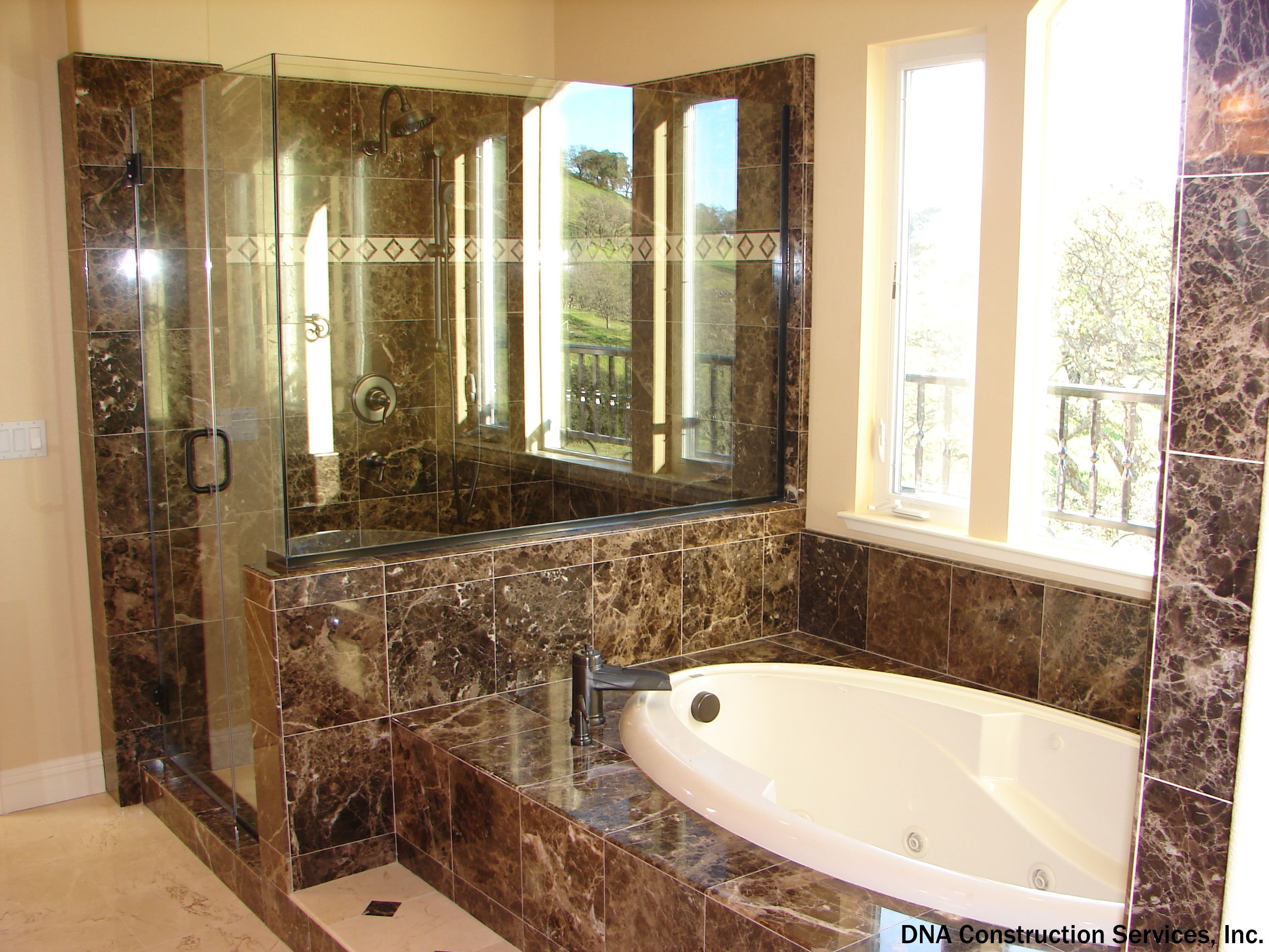 Brown Marble Tub And Shower Highlight This Master Bathroom Large Windows Above Let In Some Great Bathroom Renovation Cost Cost To Redo Bathroom Add A Bathroom