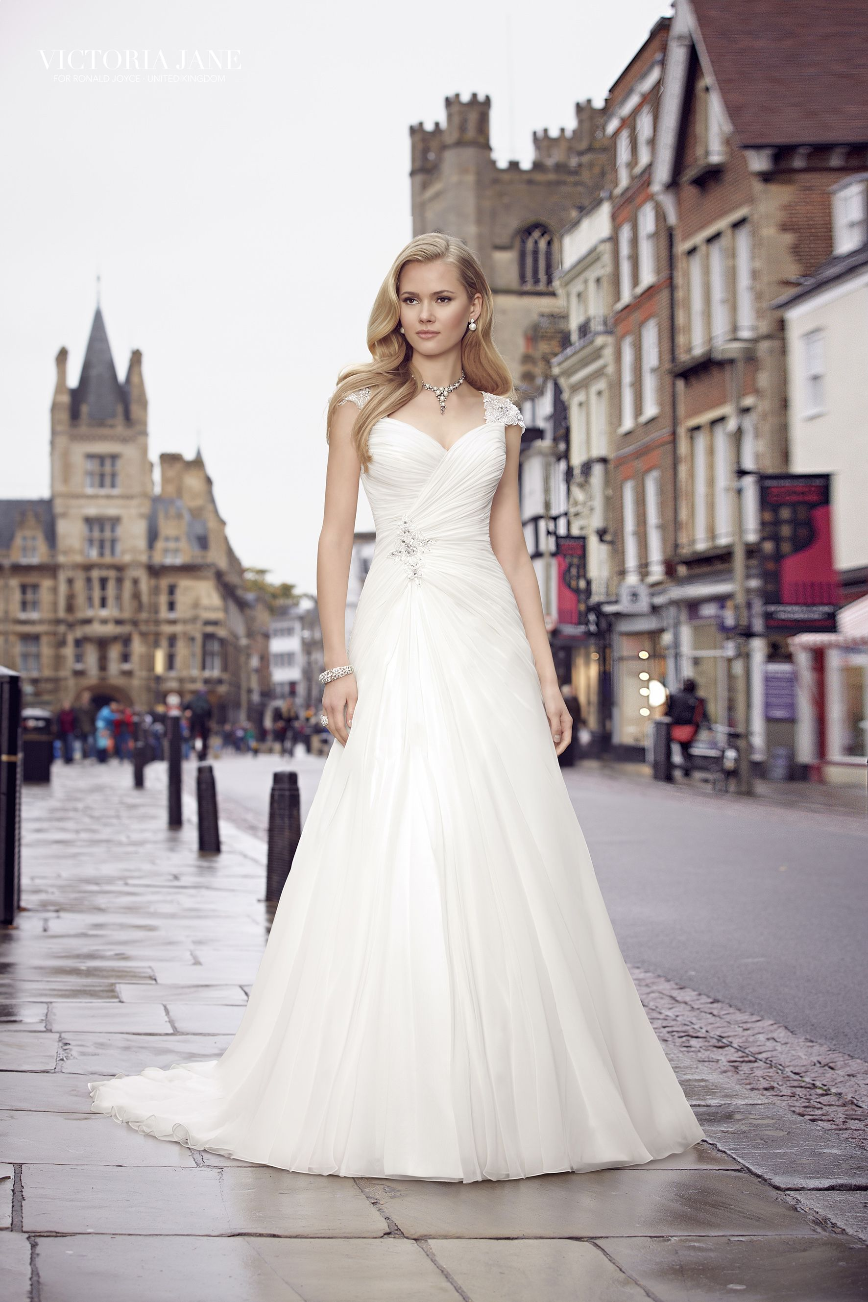 A simple & elegant wedding dress with diamante sleeves