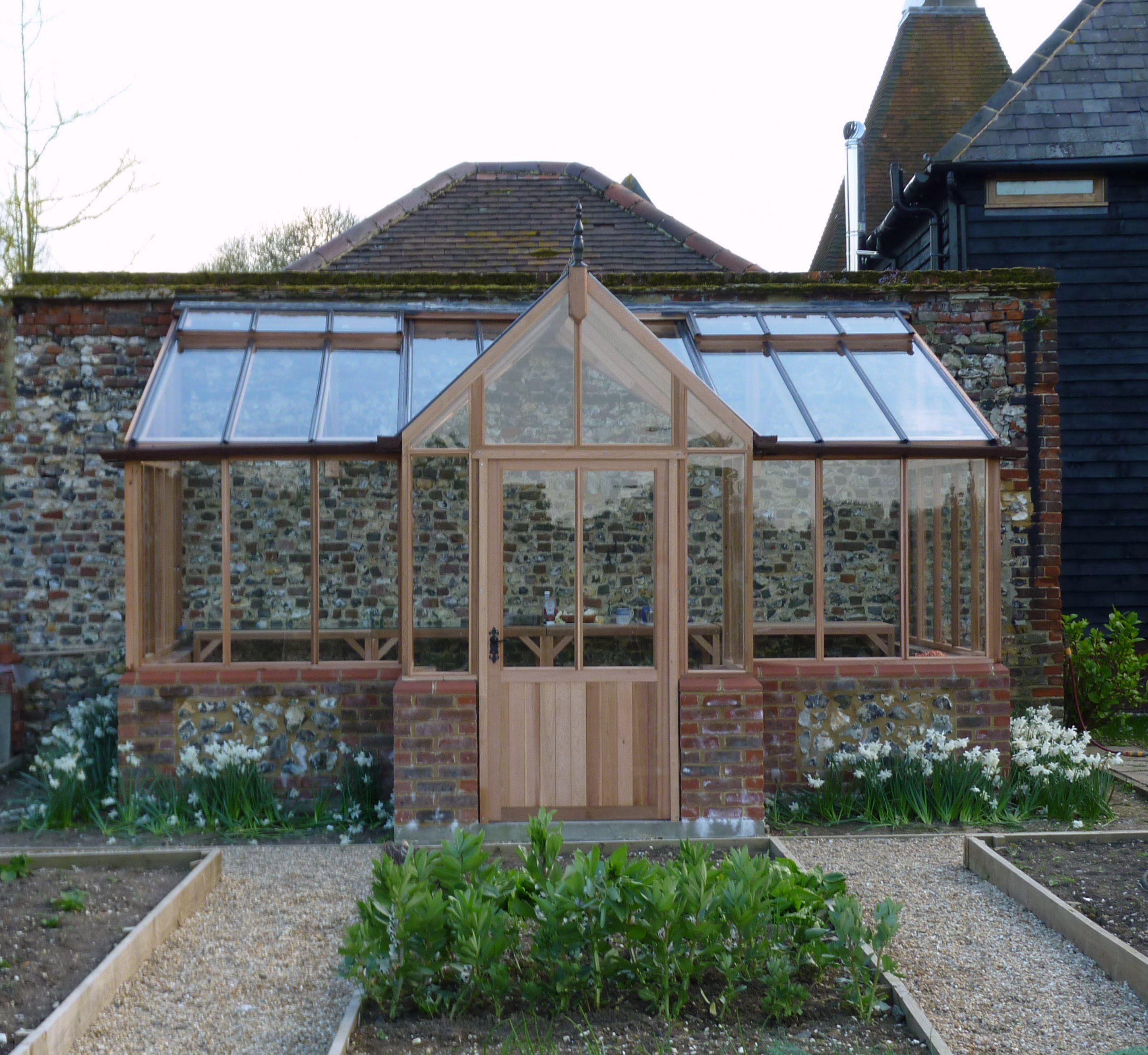 Cedar greenhouse by woodpecker joinery