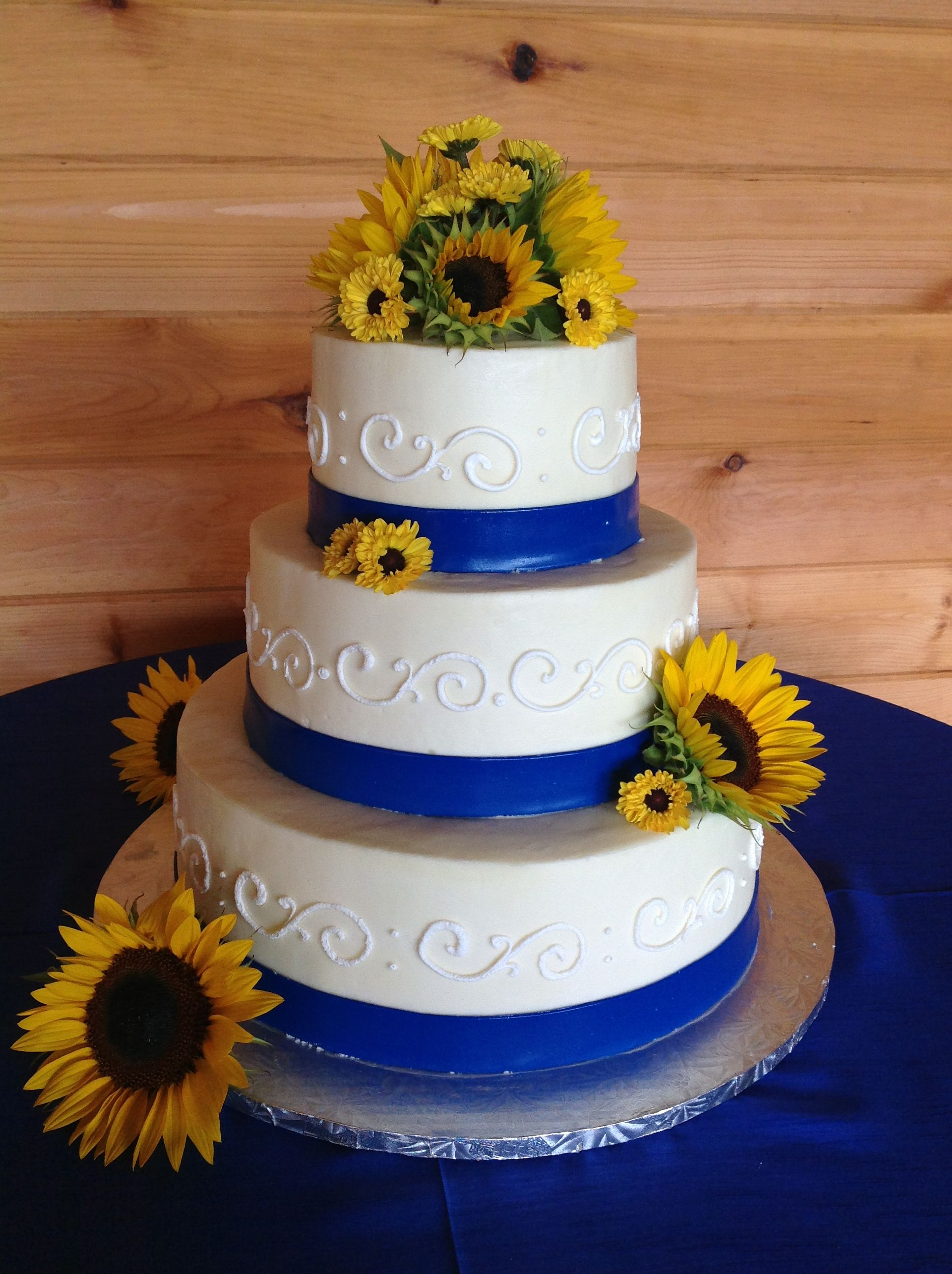 Sunflowers accent this royal blue sugar paste band