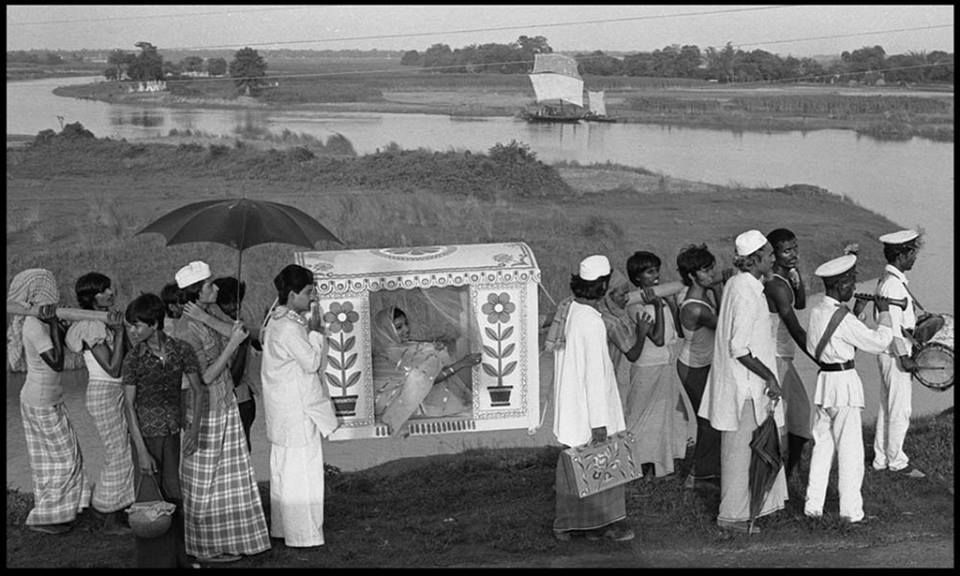 """A bride is carried by the traditional """"Palki"""" after the wedding. Bangladesh (1970s)  Original Title- """"Sailing Home""""  Photographer- Anwar Hossain."""