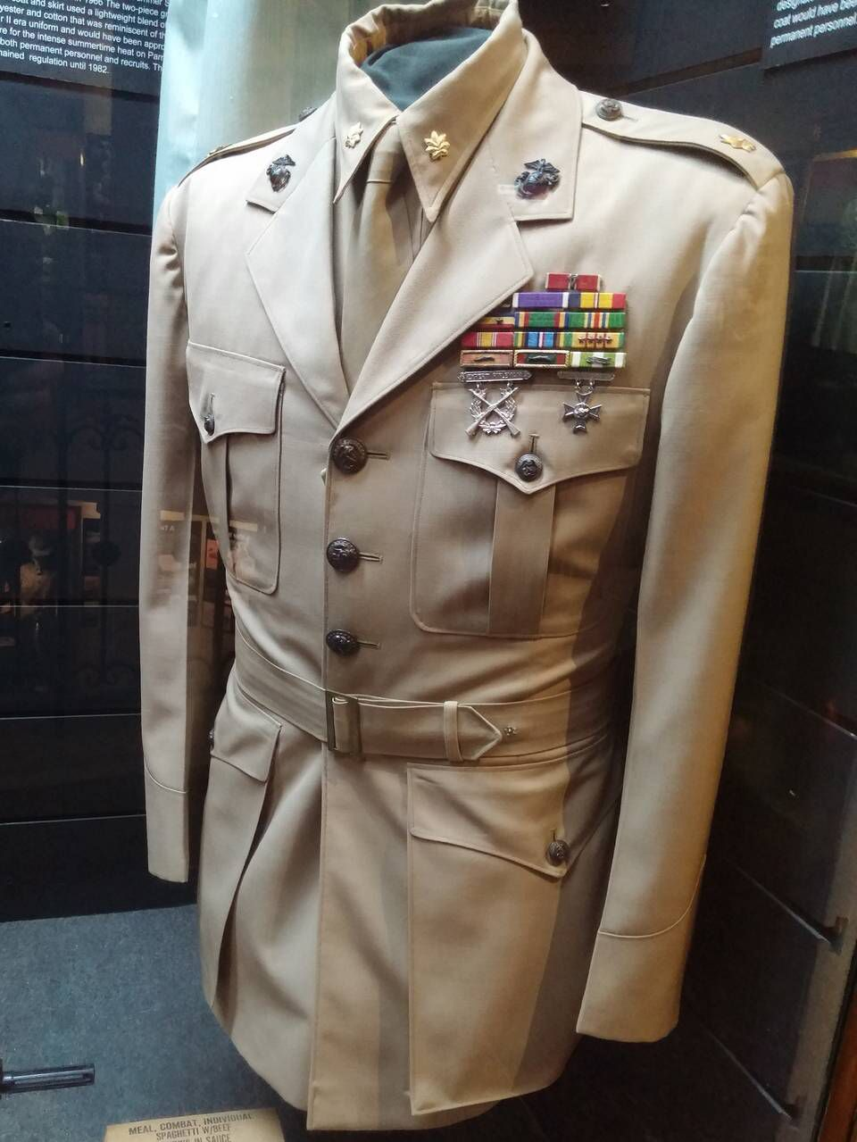 This officer's Summer Service Coat was used from the 1920s until 1976. This khaki item has a cloth tab under the left side to hang a sword. A major, signified by golden oak leaves on the shoulders, wore this 1955 specimen as part of the depot's permanent personnel. Kelly Davis  Read more here: http://www.islandpacket.com/news/local/community/beaufort-news/bg-military/article40808946.html#storylink=cpy